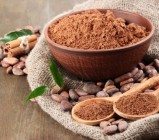Image of cocoa beans with bowl of cocoa powder